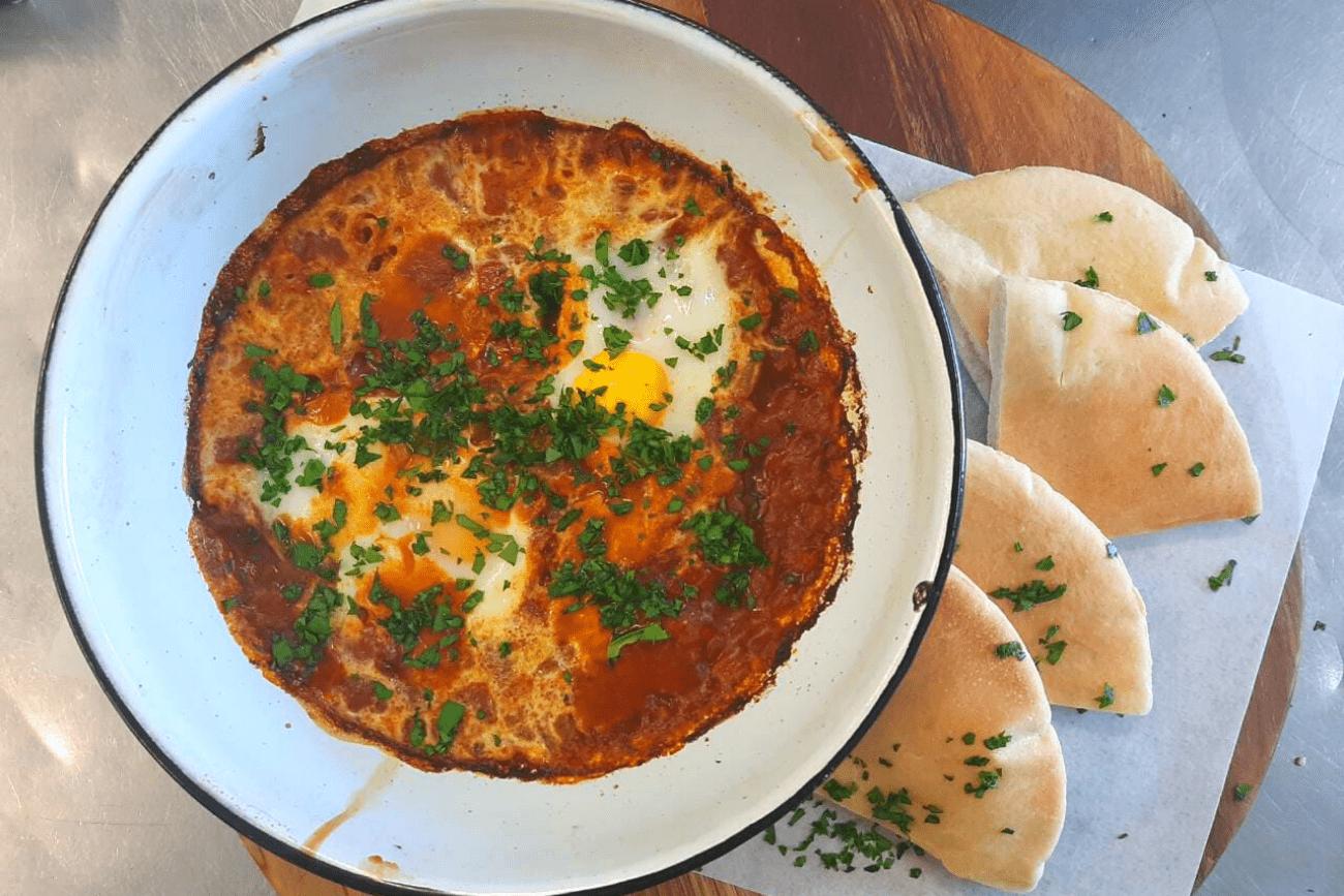 Try our new Breakfast Menu - Shakshuka, Mediterranean Breakfast Plate, Ka'ak and Jam Joy, Pita Scramble and Cheesy Eggy Breakfast Manakish